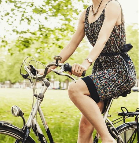 woman biking for fitness